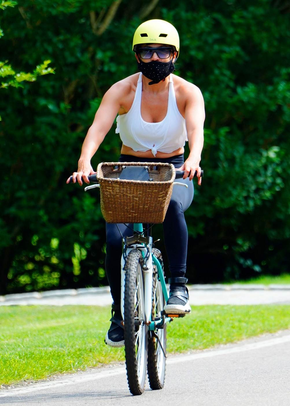 07/23/2020 Jennifer Lopez is pictured on a bike ride with a trainer ahead of her 51st birthday in The Hamptons. The pop star and actress wore a neon helmet, patterned face mask, cropped tank top, black leggings, and matching trainers.,Image: 546523374, License: Rights-managed, Restrictions: NO usage without agreed price and terms. Please contact sales@theimagedirect.com, Model Release: no, Credit line: TheImageDirect.com / The Image Direct / Profimedia